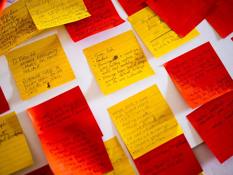 Sticky notes from a speed planning session about green buildings and houses. Photo by Scott Ball.
