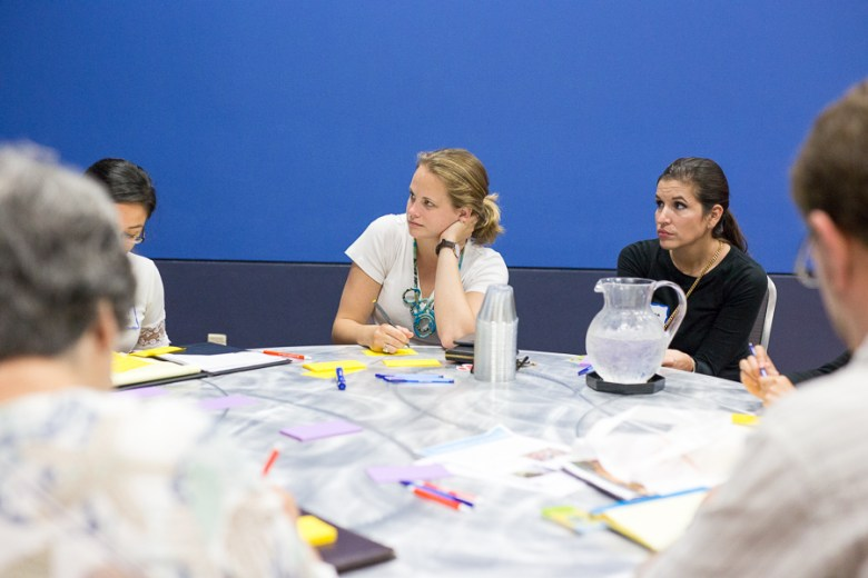 Emily Bowe (middle) listens in during a creative brainstorming session. Photo by Scott Ball.