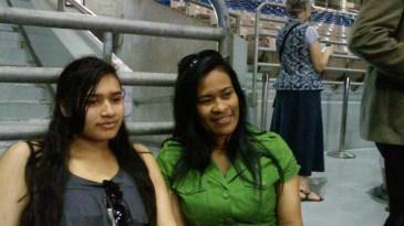 Joanna (left) and Jemimah Deonarine of New York await the next round of activities. Photo by Edmond Ortiz.