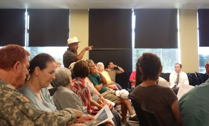 Pedro Huízar speaks in favor of the proposed development. Photo by Iris Dimmick.