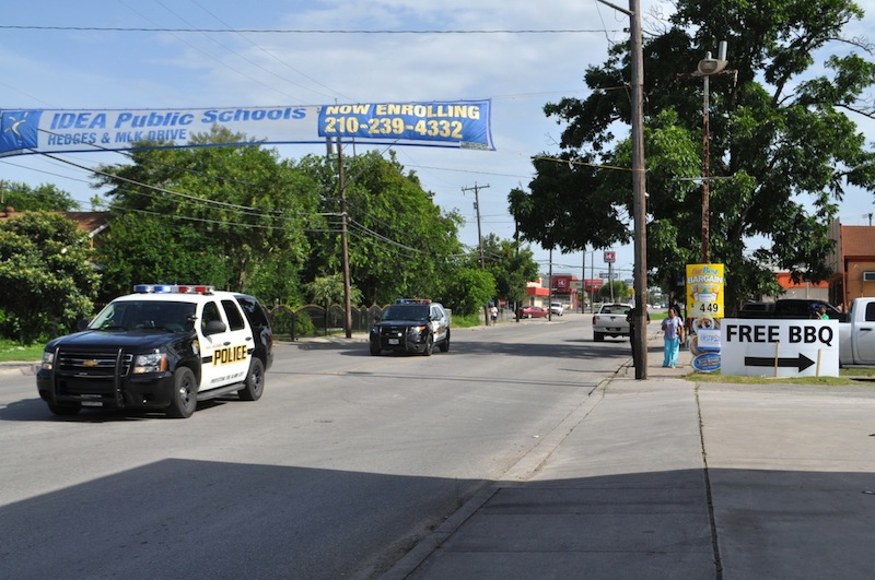 SAPD patrol vehicles speed by the Handy Shop. Photo by Iris Dimmick.