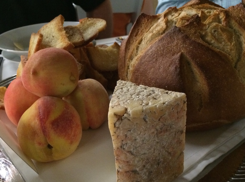 Fresh peaches, bread, and a cheese wedge awaited diners at the table as they arrived. Photo by Mitch Hagney