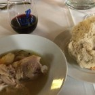 Chicken soup and whole loaf bread paired with red wine at the Witte's Salud Dinner series. Photo by Mitch Hagney