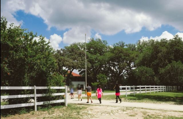 A Day in the Life of an RMYA Child: 3:00 PM The school day has ended and the residents at MeadowLand are walking back to their cabins, looking forward to some time to play and relax before dinner. Courtesy photo.