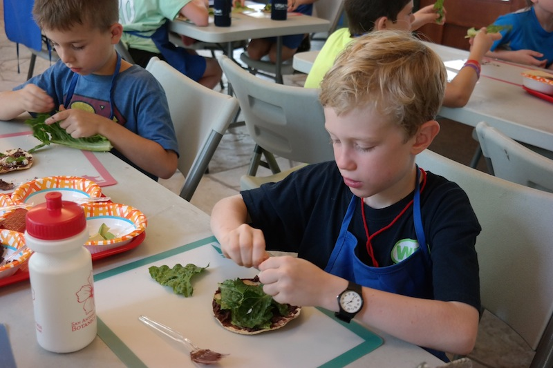 A child creates a healthy alternative snack. Courtesy Photo.