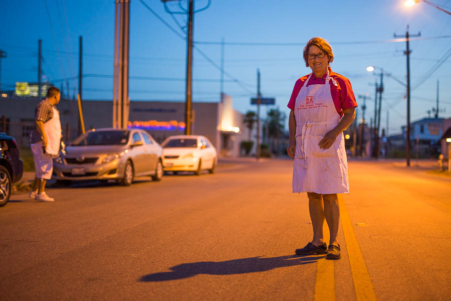 Joan Cheever poses for a photo on North Alamo Street after serving food to homeless at Maverick Park. Photo by Scott Ball.