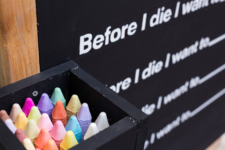 Fresh chalk is stored next to the Before I die chalkboard. Photo by Scott Ball.