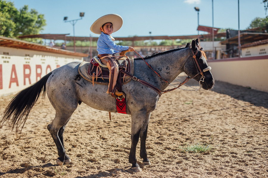 A young charro boy sits on top of his horse. Photo by Scott Ball.