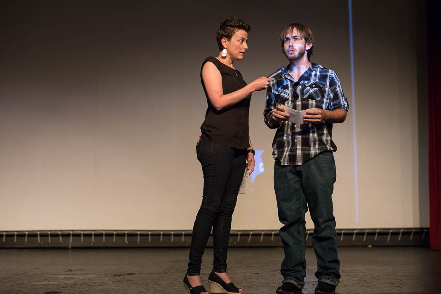 Molly Cox speaks with Taylor James Johnson. Photo by Scott Ball.