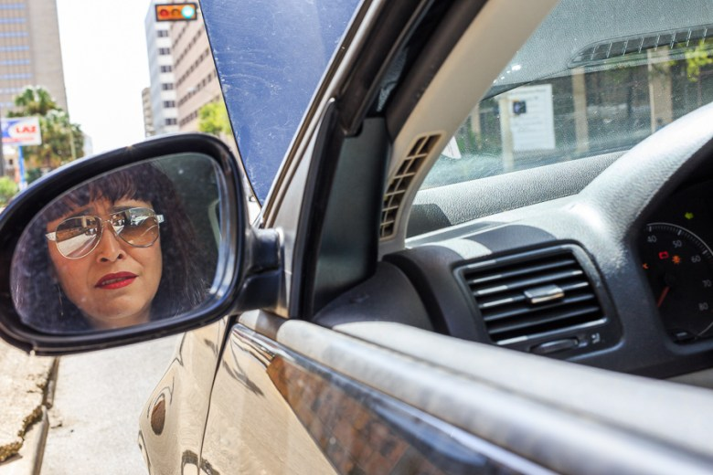 Marisela looks at her sideview mirror in anticipation. Photo by Scott Ball.