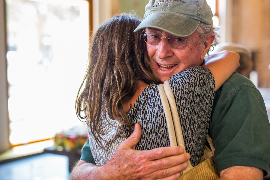 Robert Sohn, a longtime Pearl consultant who recruited Evans to San Antonio, gets an appreciate hug. Photo by Scott Ball