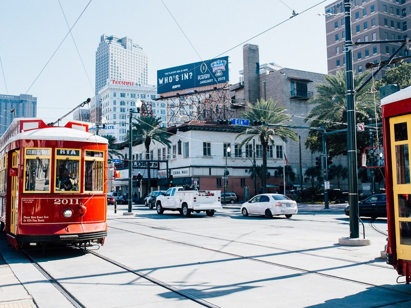 Streetcars pass each other in downtown New Orleans. Photo by Scott Ball.