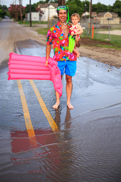 A Dignowity Hill resident expresses his excitement before wading into the pool with his baby. photo by Scott Ball