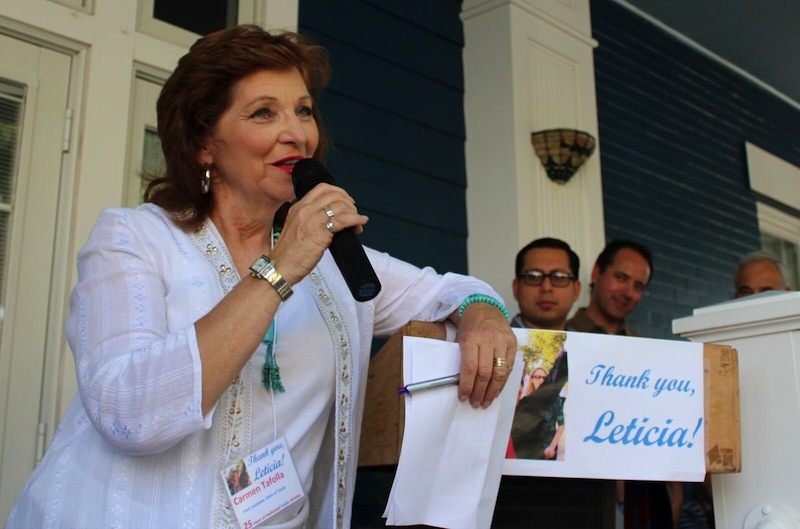 """State Poet Laureate Carmen Tafolla reads """"The Leticia Stories: a tribute to a life of service"""" to commemorate Leticia Van de Putte's work as a mother, pharmacist, state senator, and neighbor. Photo by Nicki Roberson."""
