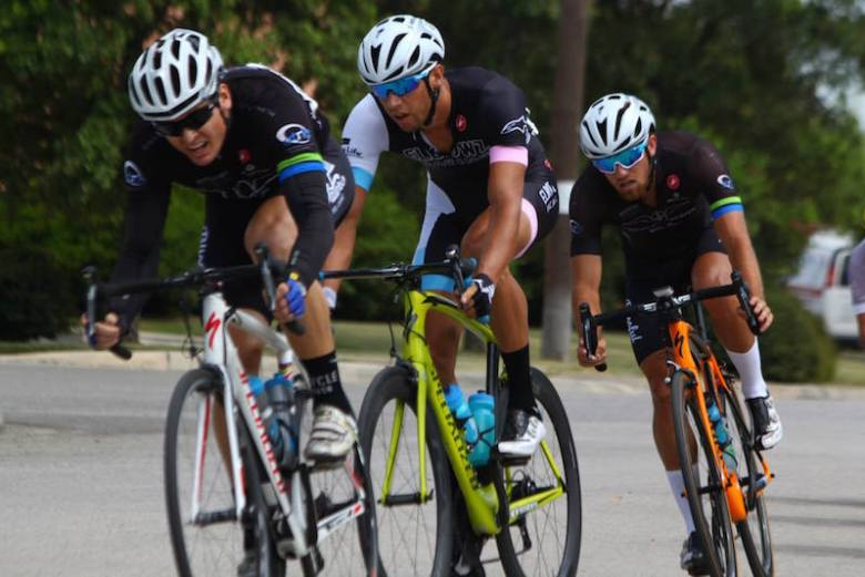 Competitive cyclists compete in a criterium race. Photo by Robert Mercado.