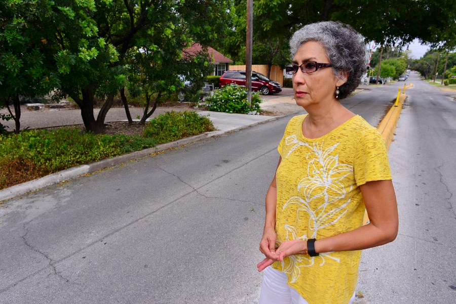 Merilu Moreno-Smith stands in front of the median in front of her home. Photo by Page Graham.