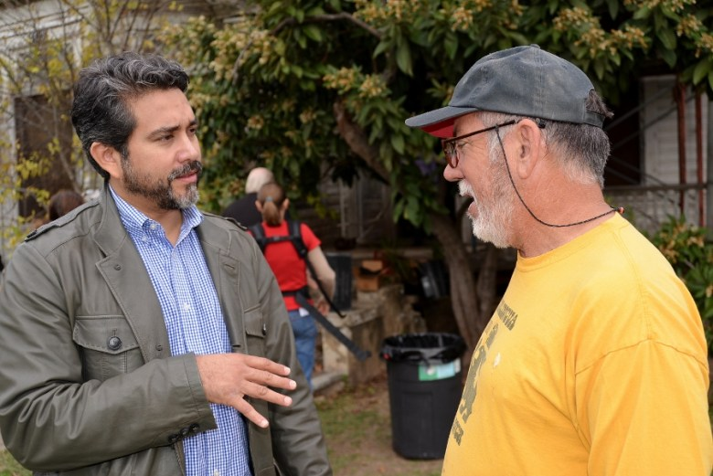 Councilmember Roberto Treviño (D1) talks to a volunteer during the December 2014 cleanup party at Miguel's home in Beacon Hill. File photo by Page Graham.