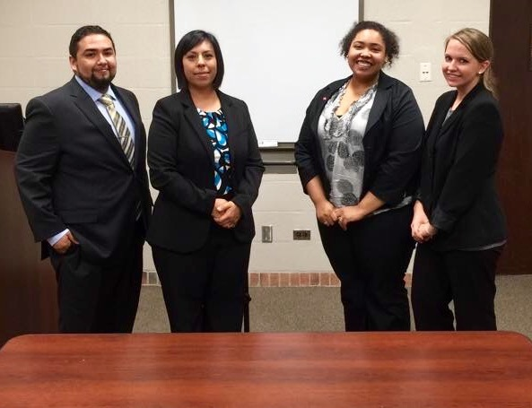 Lorna Griffin (second from left) stands with co-counsel and opposing counsel during a moot court competition at St. Mary's University School of Law. Courtesy photo.