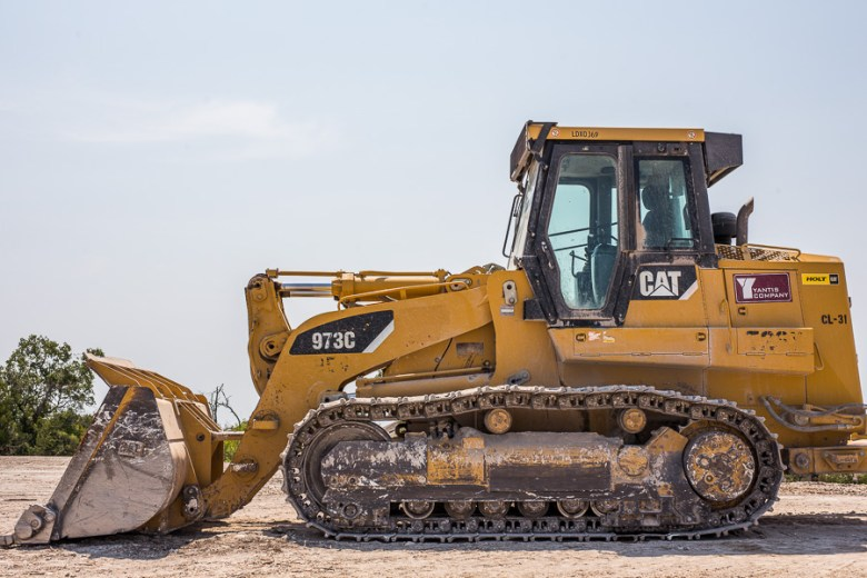 A construction vehicle sits on a recently cleared lot in Alamo Ranch. Photo by Scott Ball.