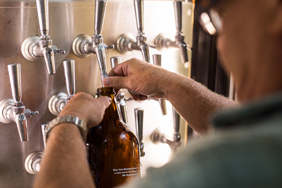 King William resident Mike Maloney, pours craft cinco peso pilsner into his growler. Photo by Scott Ball.