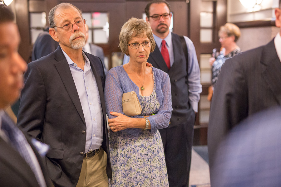 Cameron's parents Mickey (left) and Valerie Redus look on as their attorney Brent Perry speaks to reporters. Photo by Scott Ball.
