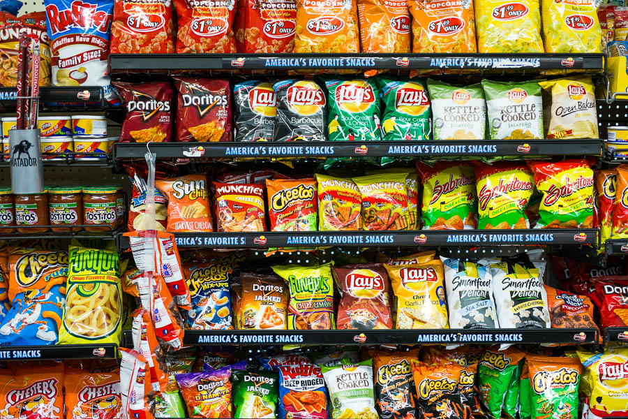 Racks of assorted snacks on display at Express Mart #4. Photo by Scott Ball.