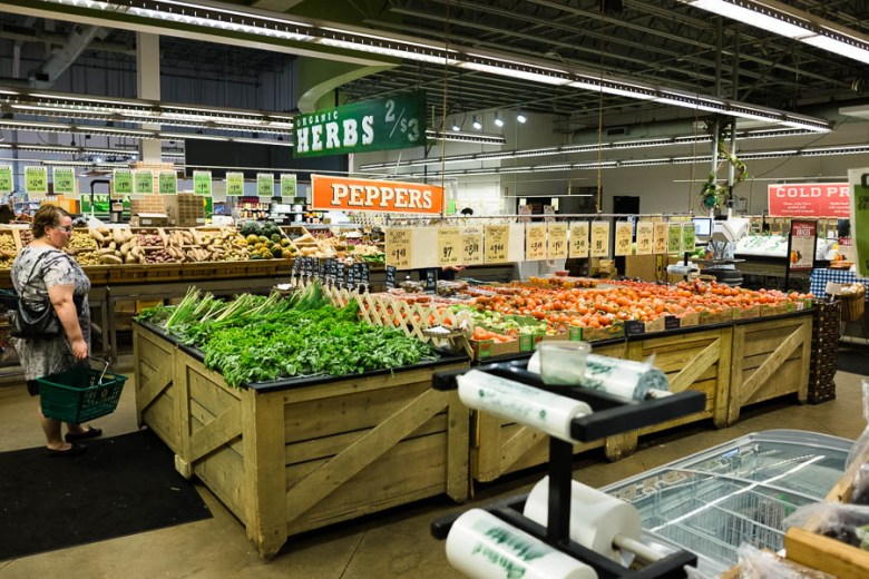A customer shops for fresh produce at Central Market. Photo by Scott Ball.