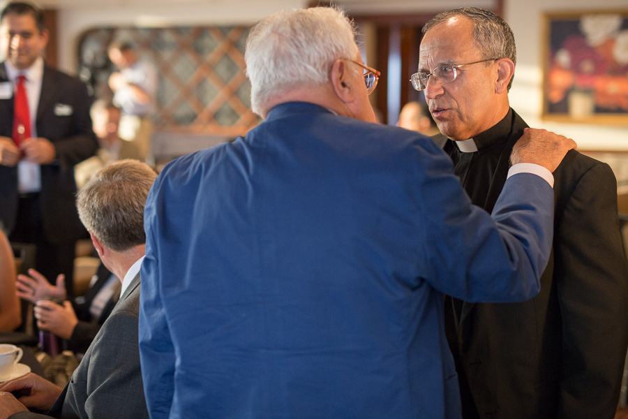 Father David speaks with a guest at the San Antonio Hispanic Chamber of Commerce 2015 Mid-Year Economic Update Breakfast. Photo by Scott Ball.