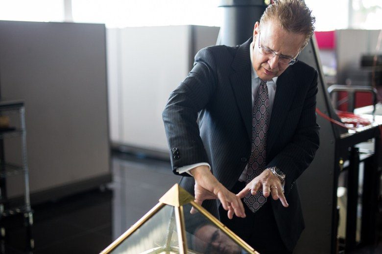 David Monroe demonstrates a piece of tech history. Photo by Scott Ball.