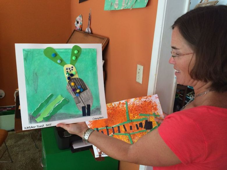 Roxana Newsom of Walden Pond shows off student art work and explains the multidisciplinary context behind the projects. Photo by Bekah McNeel