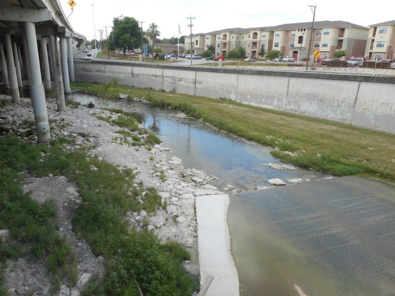 After the confluence of the San Pedro and Apache Creeks, the stream flows under IH-35 to join the San Antonio River. Photo by Don Mathis.