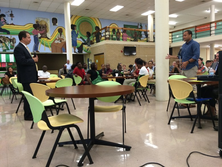 Brian Dillard poses questions to SAISD superintendent Pedro Martinez at a community input meeting at Sam Houston HS. Photo by Bekah McNeel