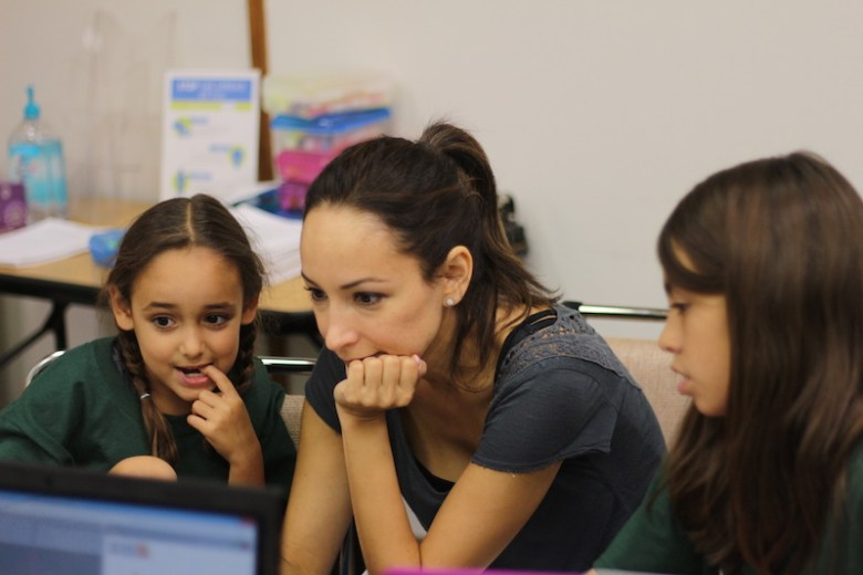 A mother and her daughters learn to code during a Code Jam session. Photo by Joan Vinson.
