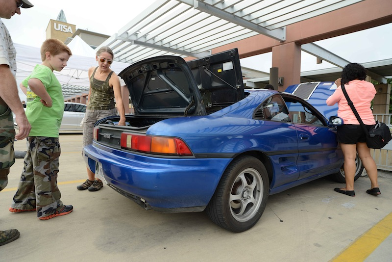 Electric vehicle owners talk about their batter-powered cars during the 2014 National Drive Day celebration. Courtesy photo.