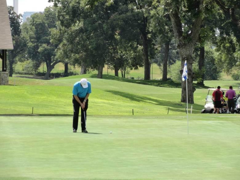 Golfers enjoy the course at Brackenridge Park Golf Course. Courtesy of Centro San Antonio.