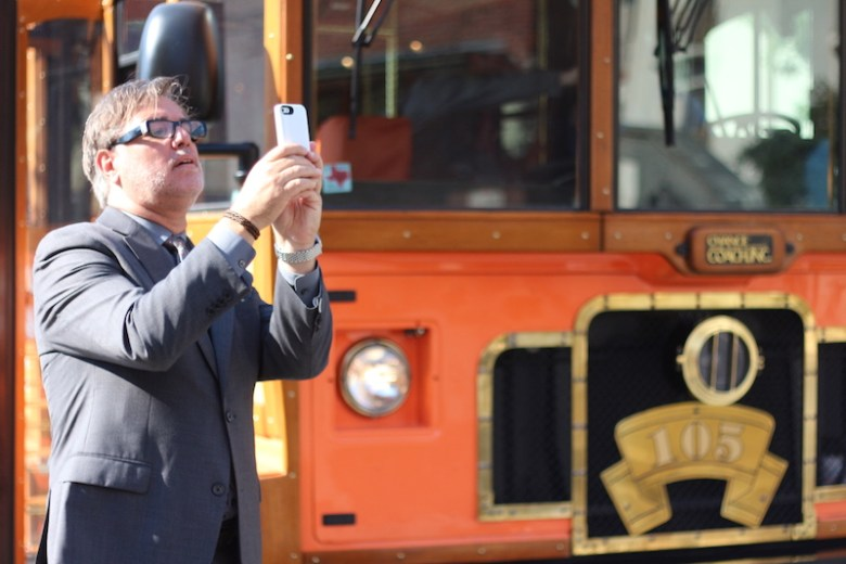 Felix Padrón, the director of the Department for Culture and Creative Development,  gets out of the bus and takes a photo during the tour. Photo by Joan Vinson.