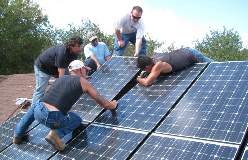A team installs solar panels in San Antonio. Photo courtesy of Build San Antonio Green.