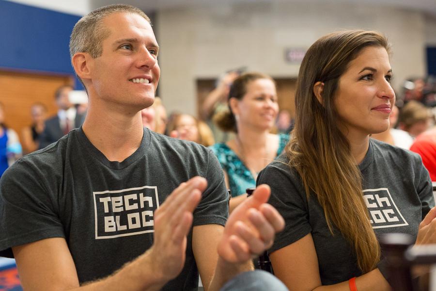 Matt Wilbanks and Marina Gavito of Tech Bloc applaud the announcement. Photo by Scott Ball.