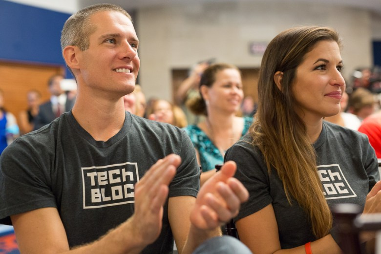 Matt Wilbanks and Marina Gavito of Tech Bloc applaud the announcement. Photo by Scott Ball.
