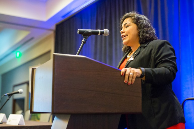 Councilmember, Rebecca Viagran (District 3), gives an introduction speech for Mayor Taylor. Photo by Scott Ball.