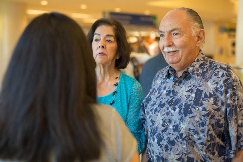 Chuck Ramirez's father, Charles Ramirez talks with guests. Photo by Scott Ball.