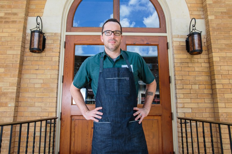 Chef Steve McHugh stands in front of his restaraunt, Cured. Photo by Scott Ball.