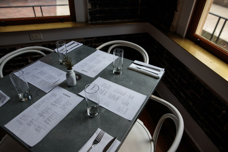 A table for four at Cured. Photo by Scott Ball.