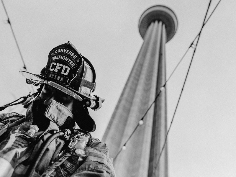 A Converse firefighter bows his head during a prayer. Photo by Scott Ball.