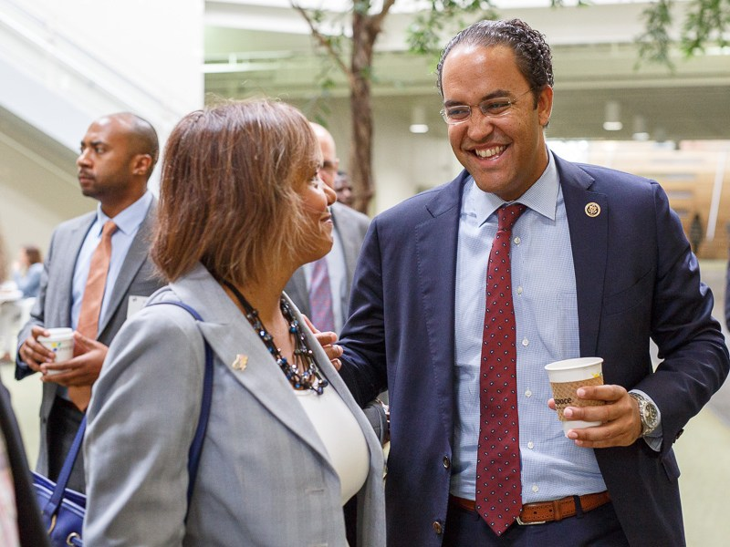 Illinois Congresswoman Robin Kelly and Texas Congressman Will Hurd chat before a tour of the Rackspace Headquarters. Photo by Scott Ball.
