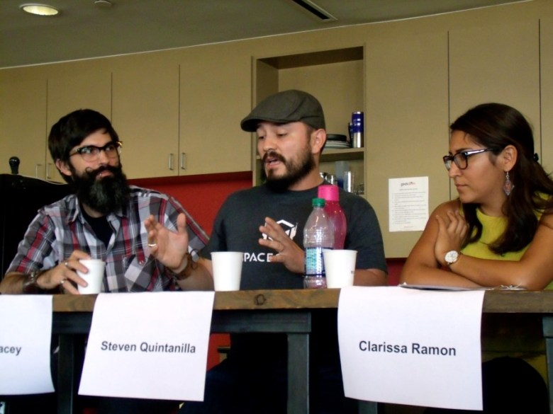 """Steven Quintanilla (center), Co-Founder of San Antonio firm SpaceCadet, talks during a tech-centric """"Coffee with the Councilman"""" event at Geekdom on Saturday, Sept. 19, 2015. Photo by Edmond Ortiz"""