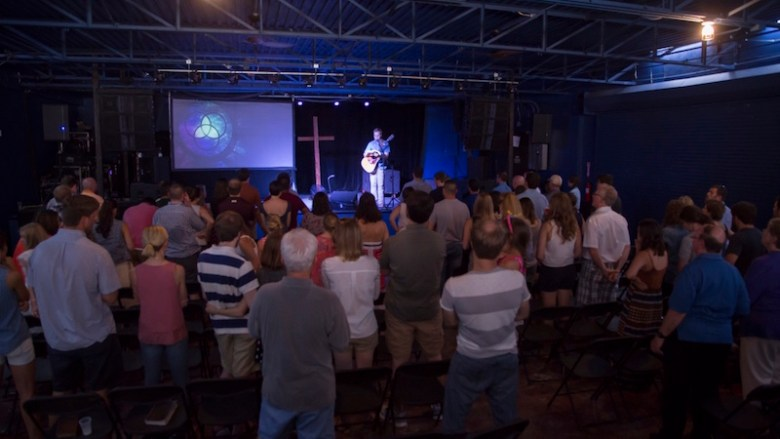 Worship leader, John McDonalds leads the congregation in a song. Courtesy photo.