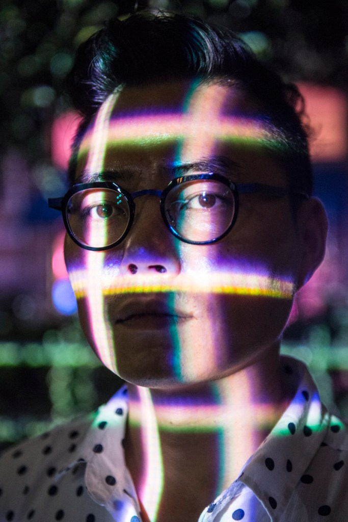 Siyon Jin poses for a portrait outside of San Antonio Museum of Art where his projections take over the facade of the building during Luminaria. Photo by Matthew Busch.