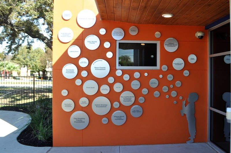 """Each silver """"bubble"""" on the wall of the Harvey E. Najim Hope Center denotes a donor. Photo by Iris Dimmick."""