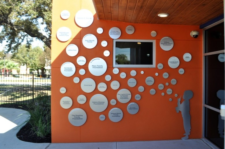 "Each silver ""bubble"" on the wall of the Harvey E. Najim Hope Center denotes a donor. Photo by Iris Dimmick."